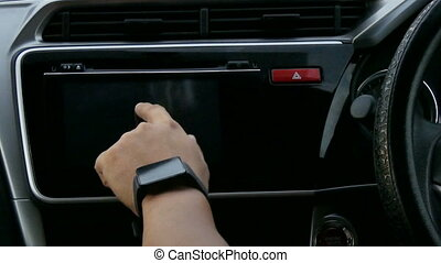 Close up shot hands of man using car touch screen monitor...