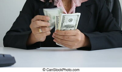 Close up shot hands of woman counting dollar bill banknote