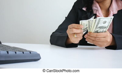 Close up shot hands of woman counting dollar bill banknote with ambient sound