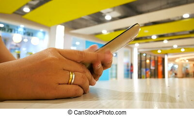 Close up shot hands of woman using smart phone select focus shallow depth of field