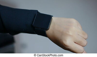 Close up shot hands of woman using smart watch
