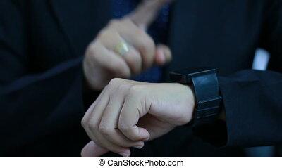 Close up shot hands of woman using smart watch