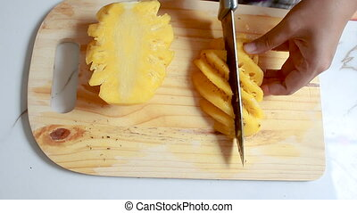 Close up shot hands of women using kitchen knife to cutting...