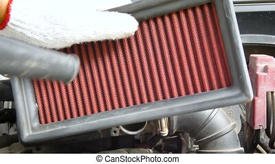 Close up shot mechanical using electric Blowers air force blowing to car engine filter for cleaning the dust with ambient sound