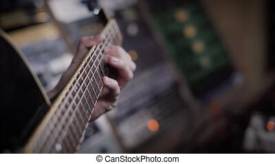 Close up shot of a bass guitarist playing on an instrument...