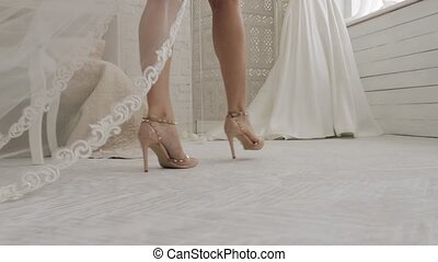 Close up shot of a bride's legs with her new dress on their wedding day