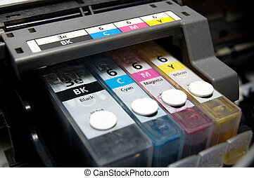 CMYK - close-up shot of a CMYK ink cartridges for a color...