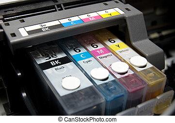 CMYK - close-up shot of a CMYK ink cartridges for a color...