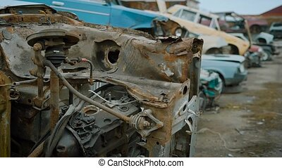 Close up shot of a dump of old and broken cars. Plenty of...