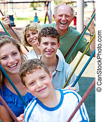 Close-up shot of a family playing in the playground