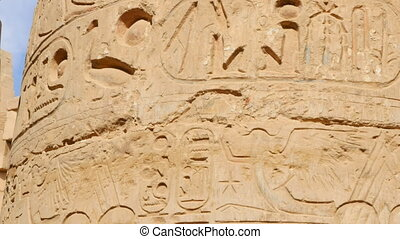 Symbols of Ancient Egypt on the Building. These Symbols and Signs Considered to be an Unknown Language of Egyptians Who Lived Here. Picture with Repeating Bird Pattern is Carved on a Stone Surface.