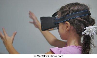 Close-up shot of a girl teen in headphones indoor getting...