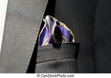 Close-up shot of a handkerchief in suit pocket.