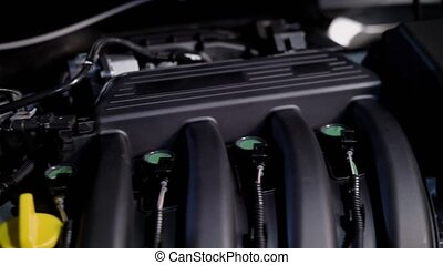 Close up shot of a parts of the vehicle under the hood in...