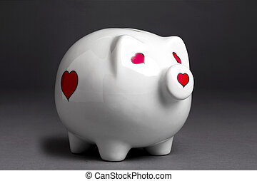close up shot of a piggy bank with heart shape