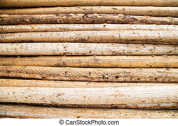 close up shot of a pile of logs in a timberyard, great as a background