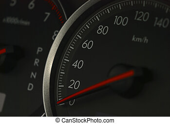 shot of a speedometer in a car.