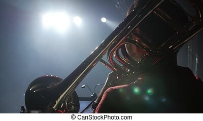 Close up shot of a trombone being played on a gig.