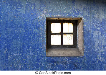 close up shot of a wall and a old window