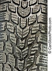 Close up shot of a wet car tire