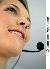 Close-up shot of a woman wearing a headset