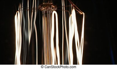 Close up shot of adison lamp - Endless power. Close up of an...