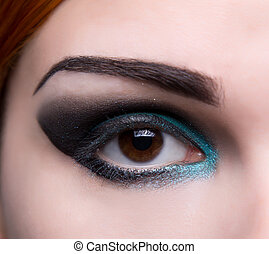 Close-up shot of an eye with artistic makeup