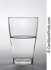 close up shot of an half full water glass