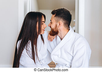 close up shot of attractive woman leaning on the handsome guy