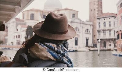 Close-up shot of beautiful Caucasian travel blogger girl...