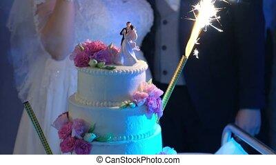 Beautiful wedding cake with burning candles. - Close-up shot...