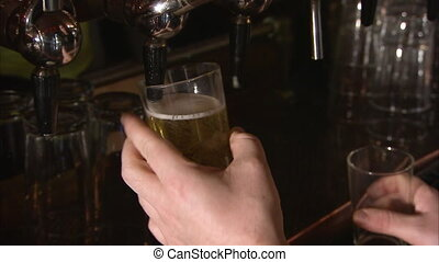 Close up shot of beer being poured