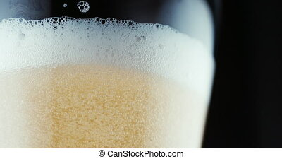 Beer is poured in glass. - Close up shot of Beer is poured...