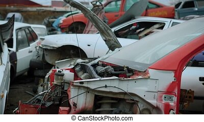 Close up shot of broken and torn apart cars lying on...