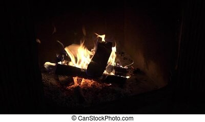Close up shot of burning firewood in the fireplace