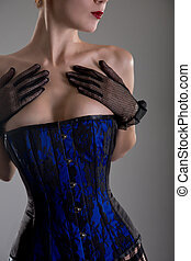 Close-up shot of busty burlesque woman in black and blue...