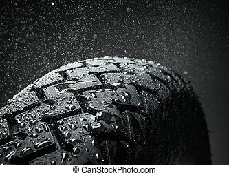 Close-up shot of classical motorcycle tire tread in wet ...