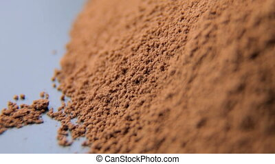 Close up shot of cocoa powder - cocoa powder for making hot...