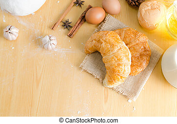 Close up shot of Croissant and bekery ingredients on wooden table with copy space