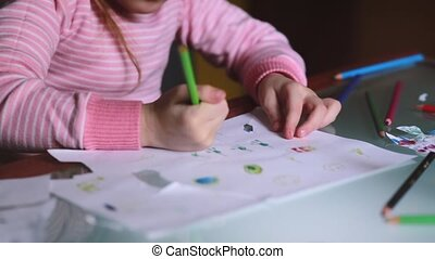 Close-up shot of cute Caucasian little girl learning to draw...