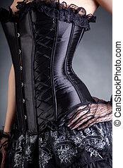 Close-up shot of elegant woman in black corset