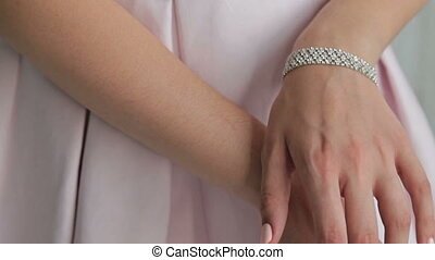 Close up shot of elegant woman's hands