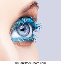 Close-up shot of female eye blue make-up
