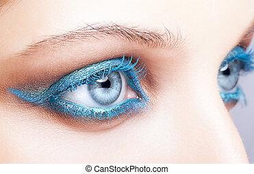 Close-up shot of female eyes blue make-up