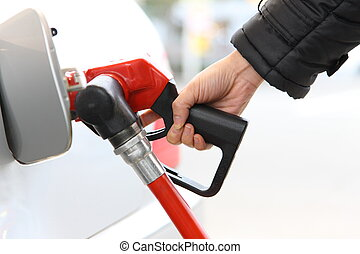 filling gas - close up shot of filling gas at gas station