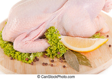 Close-up shot of fresh raw chicken with condiments