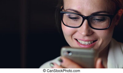 Close-up shot of good-looking girl wearing glasses using...