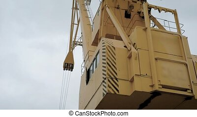 Close up shot of grab bucket crane for waste management. -...