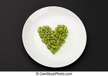 green soya beans arranged in heart shape