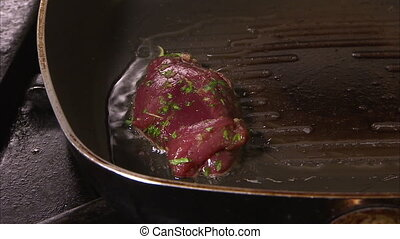 Close up shot of hand placing meat to cook - Close up shot...